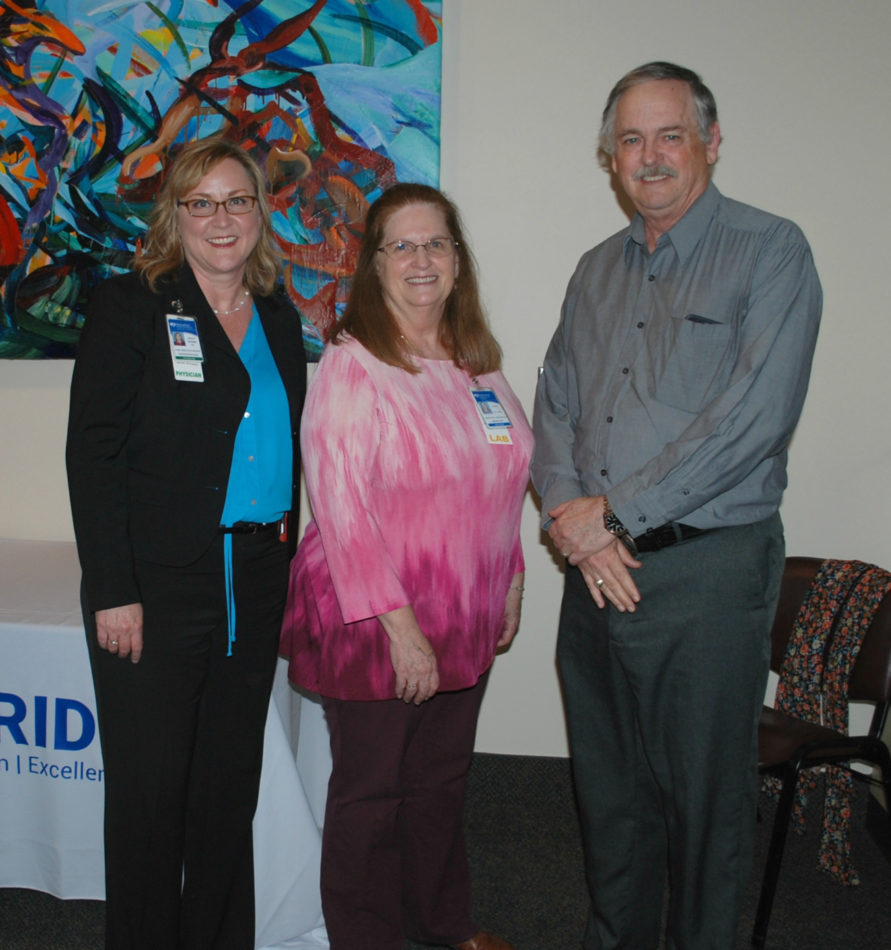 35-year employee Diane Welsh poses with CEO Dr. Lesley Ogden and her Laboratory manager, Stewart Pritchard.