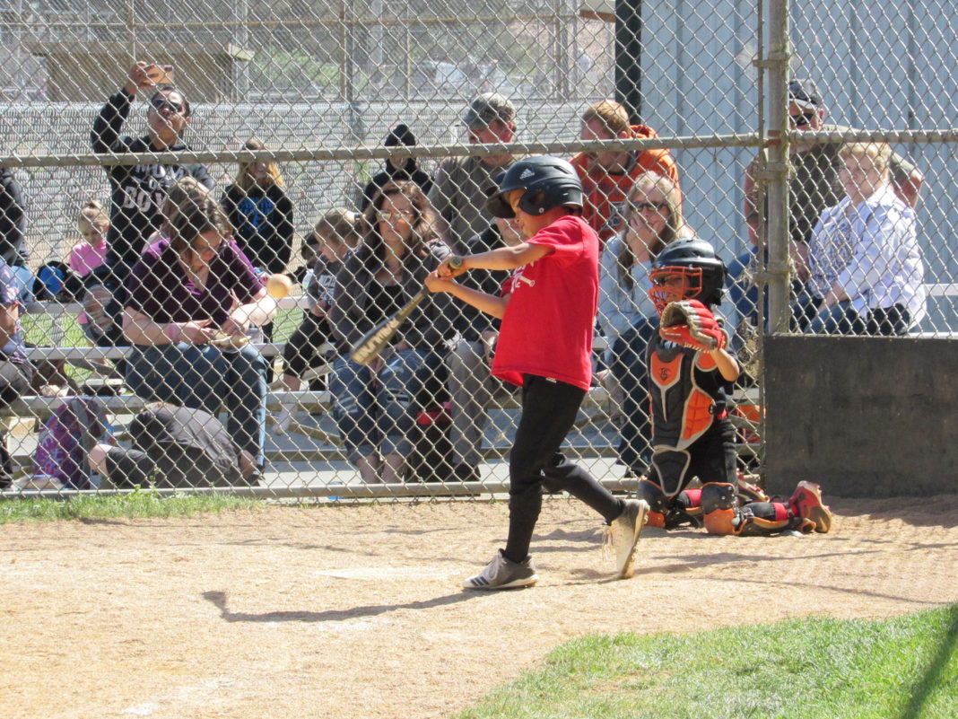 Kids nails one to the outfield