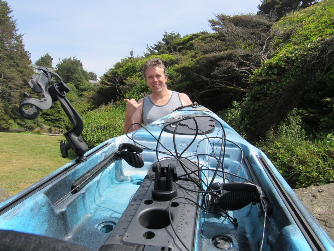 Lincoln City's John Duncan shows his kayak at Canyon Drive Park
