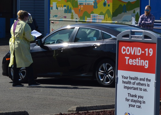A car pulls into the Samaritan Health's COVID-19 mobile test center in Depoe Bay.
