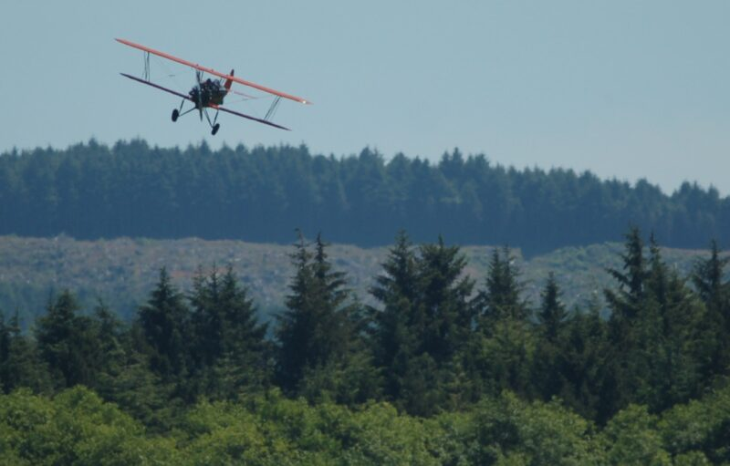 Pilot Dana Anderson slips into the wind on approach to Siletz Bay State Airport, five miles south of Lincoln City